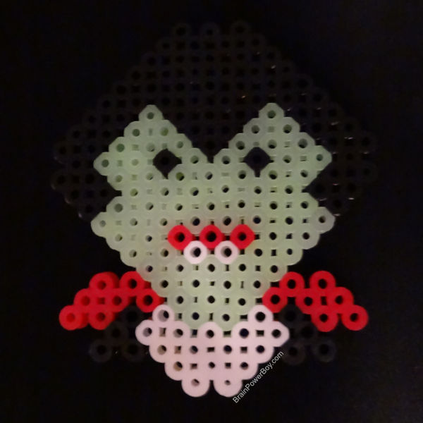 Glow in the dark Perler Beads used on the face of the Vampire.