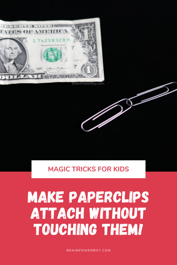 Magic Trick shows dollar bill and two paperclips.