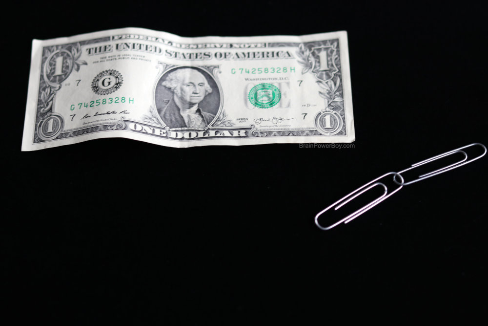 dollar bill and two paperclips for jumping paperclips magic trick