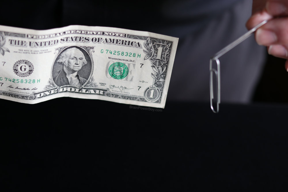 paperclips magically attached together off dollar bill