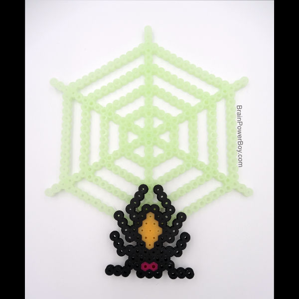 Completed spider and spider web project with glow in the dark Perler beads