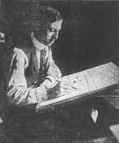 Picture of Rube Goldberg working at his desk.