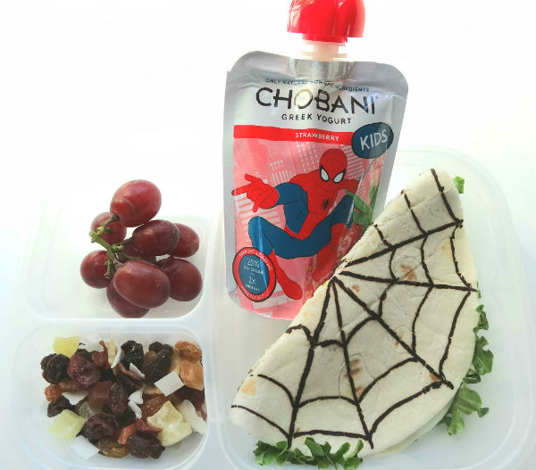 Take a cheese sandwich and give it a superhero twist. This Spiderman sandwich is made with a tortilla and includes plenty of white cheese and lettuce. A fruit selection and Chobani Kids Greek Yogurt strawberry pouches, make the lunch even more nutritious and tasty. Created by BrainPowerBoy.com, sponsored by Chobani.