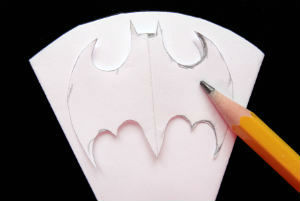 Trace Batman snowflake template onto snowflake