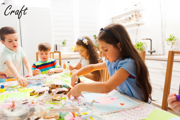 boys and girls making crafts together