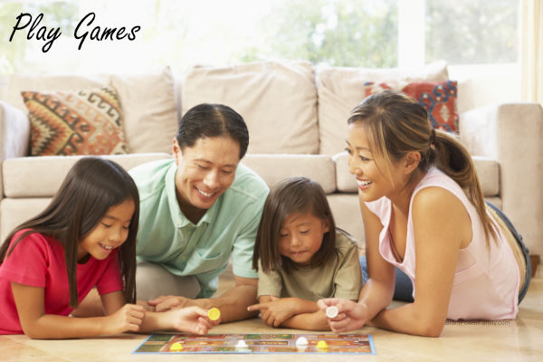 family playing a board game together at home