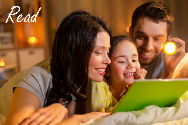 family reading books together at night