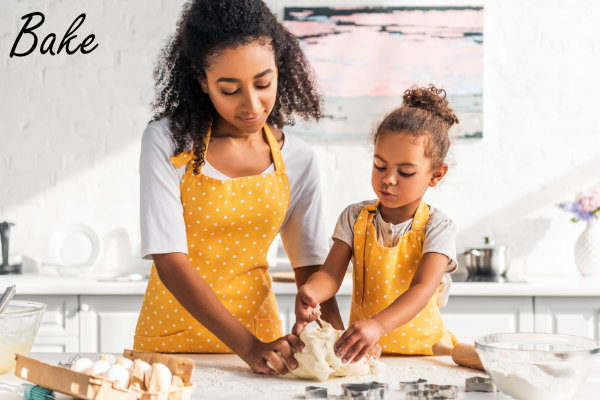 Mom and daughter baking cookies together